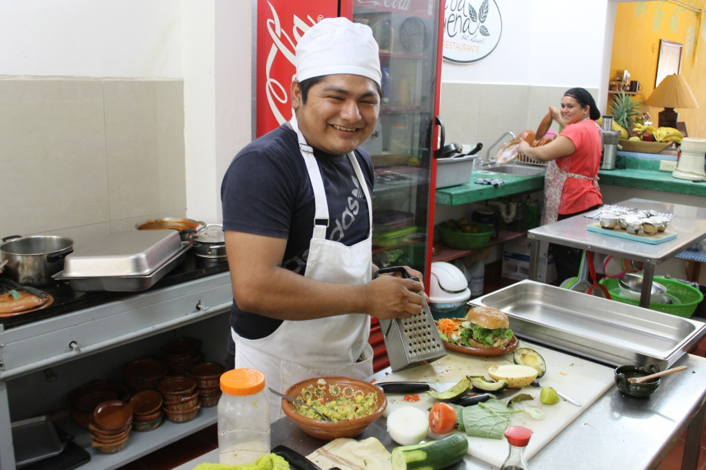 One happy chef, preparing a giant vegetarian burger